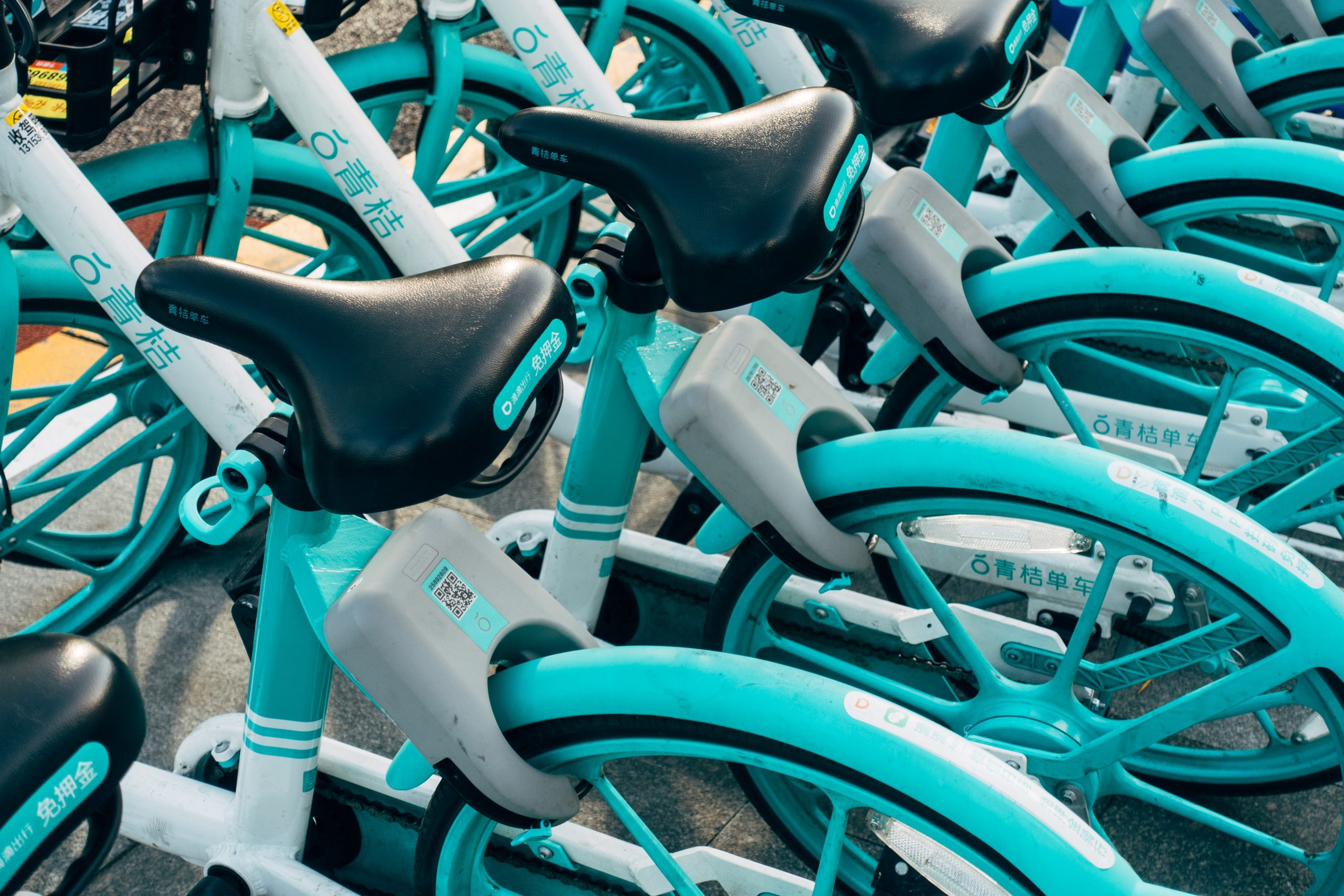 teal-bicycles-on-a-parking-lot-3671179